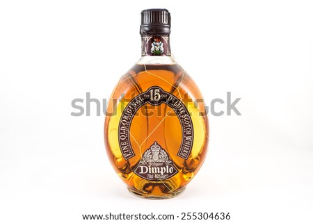 A bottle of fine and rare 15 years old Dimple de Luxe Scotch James Whiskey. Illustrative editorial, the photo was taken on February 22, 2015 in Porto, Portugal - stock photo