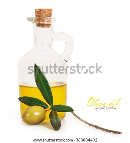 A bottle of olive oil and olive branch next to the bottle isolated on a white background - stock photo