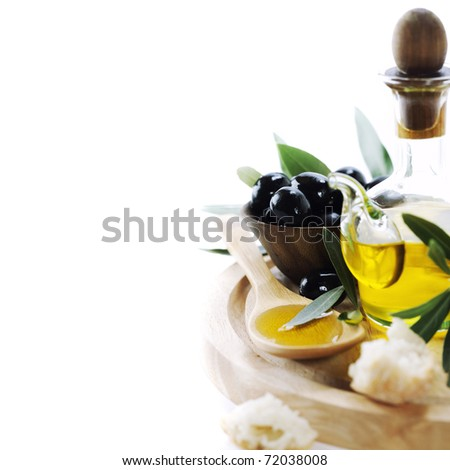 A bottle of olive oil and olives over white - stock photo