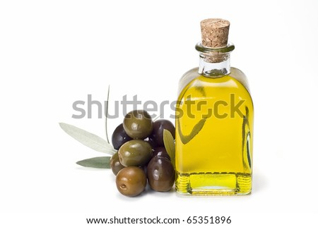 A bottle of olive oil and some olives isolated on a white background. - stock photo