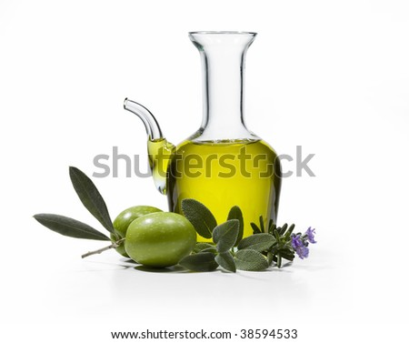 A bottle of olive oil with two olives and spices on white background - stock photo