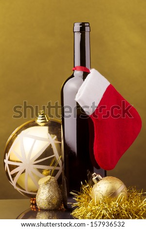 a bottle of red wine Christmas decoration, red and white Christmas sock - stock photo