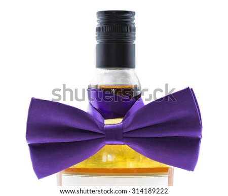 A bottle of strong alcohol tied with a violet bow - stock photo