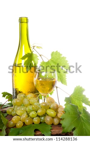 A bottle of wine and a glass of wine standing on an old wooden barrel. Isolation.