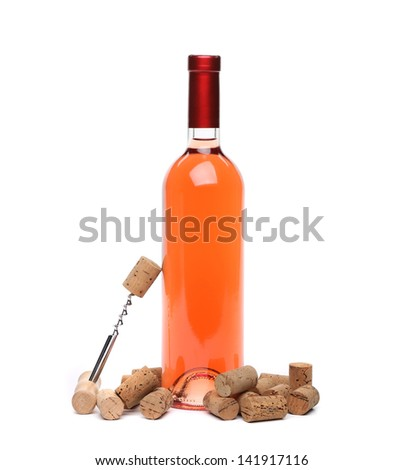 A bottle of wine, corks and corkscrew isolated on the  white background. - stock photo