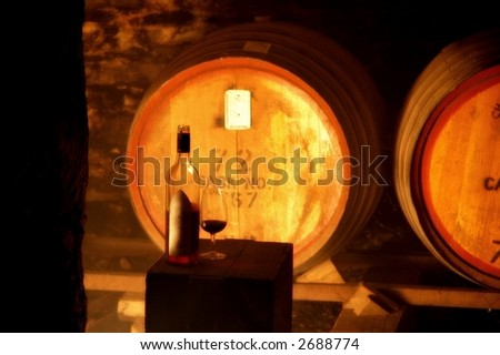 A bottle of wine in an old underground cellar - stock photo