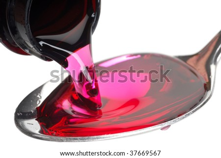 A bottle pouring cough syrup into a spoon with a white background