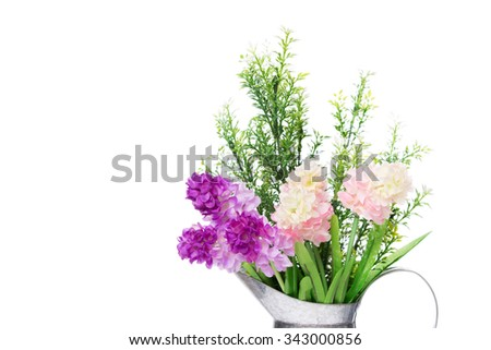 A bouquet of artificial  flowers in galvanize can isolated  on white background - stock photo