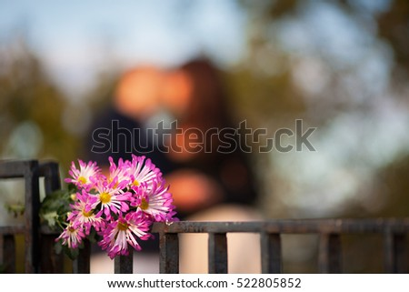 a bouquet of flowers on a background of a couple in love