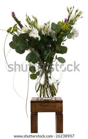 A bouquet of flowers on a small table