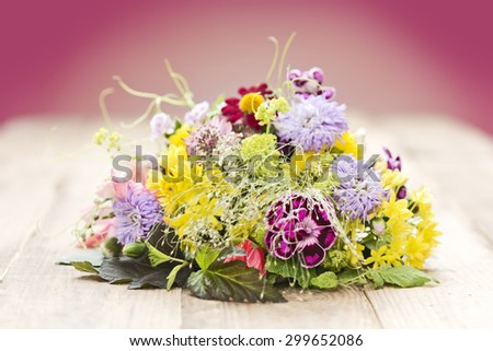 a bouquet of flowers on a table with red background
