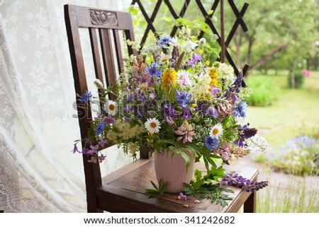 A bouquet of flowers on the veranda