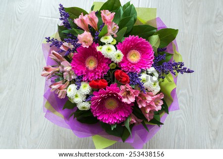 A bouquet of flowers with a gerbera - stock photo