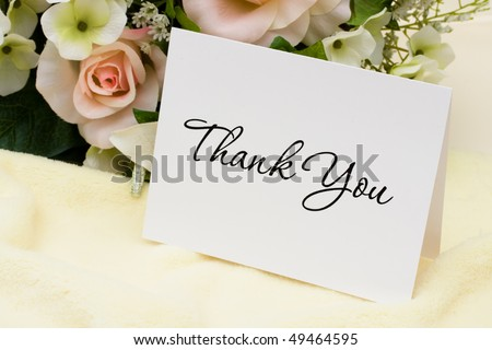 A bouquet of flowers with a thank you card, thank you card - stock photo