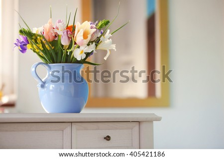 A bouquet of fresh flowers in a vase, close up - stock photo