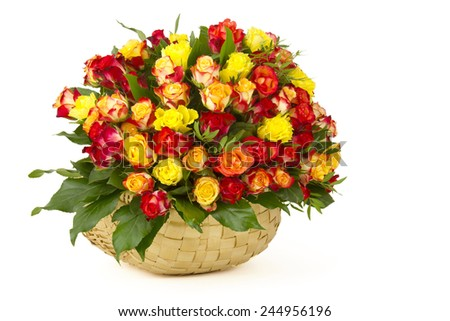 A bouquet of multicolored roses in a basket - stock photo
