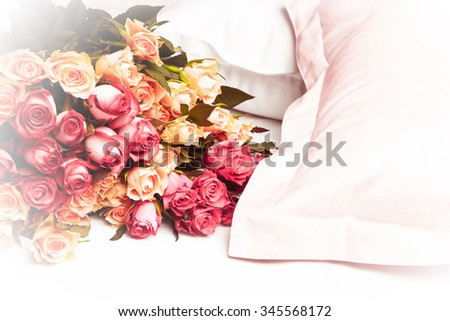 A bouquet of multicolored roses on a pillow. Floral pattern. Vintage time. Horizontal - stock photo