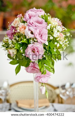 a bouquet of pale pink flowers, wedding decoration