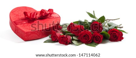 A bouquet of red roses and a red heart for Valentine's Day