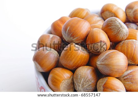 A bowl full of hazelnuts