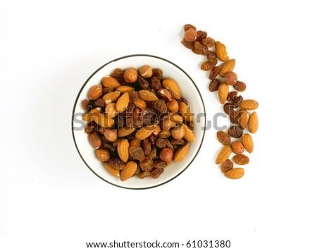 a bowl full of raisins, almonds and hazelnuts - stock photo
