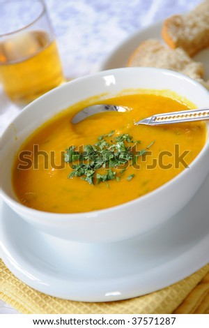A bowl of carrot and lentil soup - stock photo