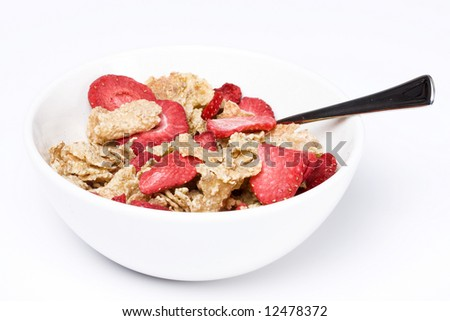 A bowl of cereal with strawberries - stock photo