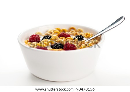 A bowl of cereals with fresh blackberries and raspberries with milk in a white background. - stock photo