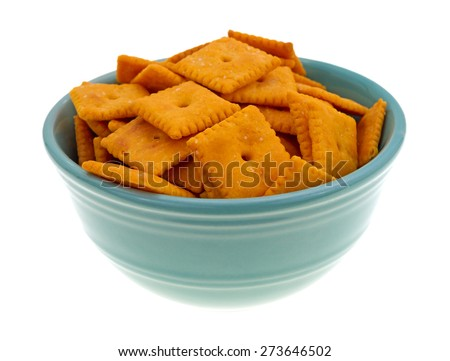 A bowl of cheese snack crackers isolated on a white background. - stock photo