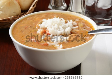 A bowl of chicken and smoked sausage gumbo with white rice - stock photo