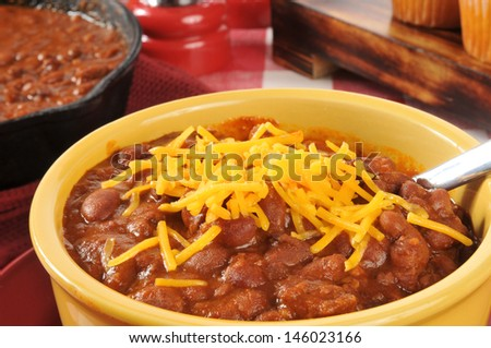 A bowl of chili con carne with cheddar cheese - stock photo