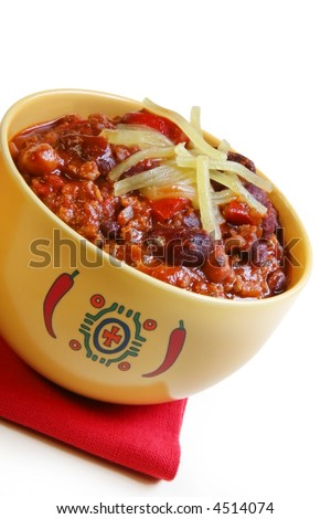 A bowl of chilli with beans, topped with grated cheese. - stock photo