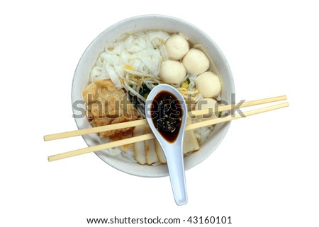 A bowl of Chinese flat noodles or 'koay teow' with fish balls, fish cakes, bean sprouts and 'fuchuk' - stock photo