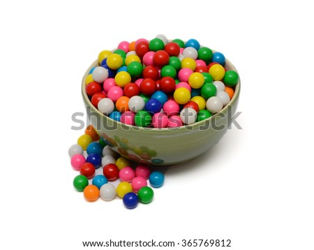 A bowl of colored shiny round gumballs - stock photo