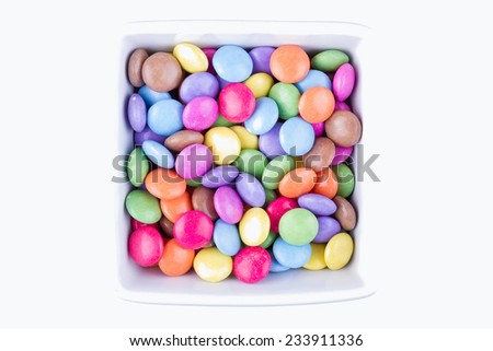 A Bowl of Colorful Chocolate Coated Candy on White Background  - stock photo