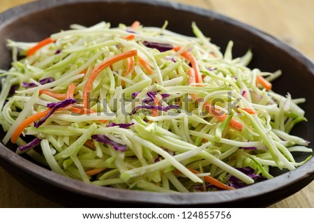 A bowl of crispy coleslaw close up. - stock photo