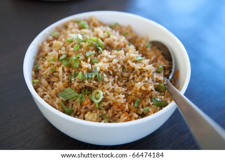 A bowl of delicious oriental fried rice - stock photo