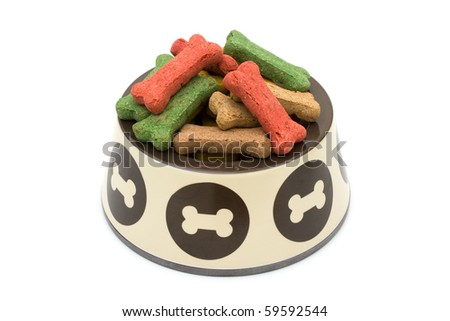 A bowl of dog treats isolated on a white background, treat your dog - stock photo