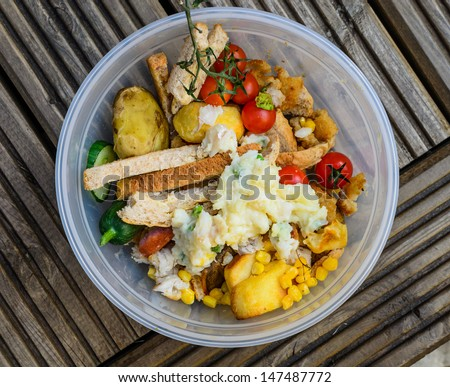 A bowl of food recycling waste on a wooden background - stock photo