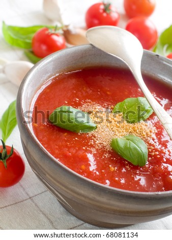 A bowl of  fresh gazpacho (cold tomato soup). - stock photo