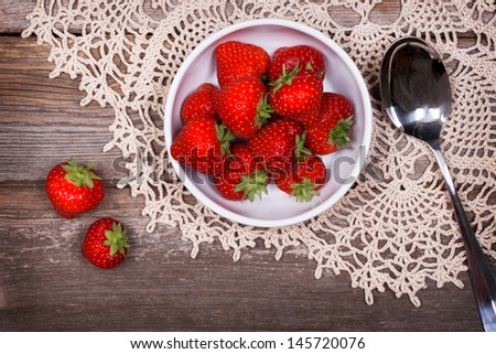 A Bowl Of Fresh Ripe Strawberries On Lace Tablecloth And Rustic Wood Table.  Vintage Effect