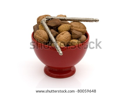A bowl of healthy nuts in shell isolated on white, healthy eating - stock photo