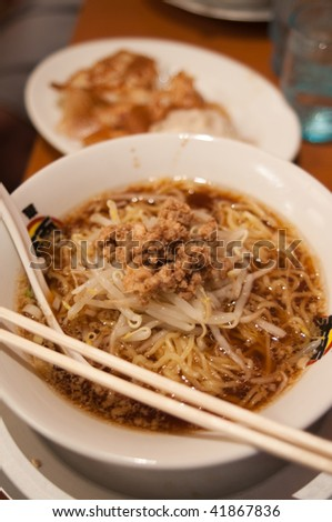 A bowl of kake ramen inside a restaurant in Tokyo, Japan. - stock photo