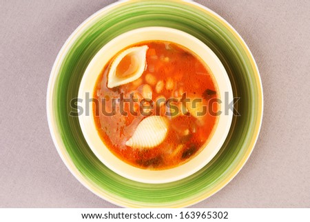 A bowl of minestrone soup, sprinkled with parmesan cheese  - stock photo