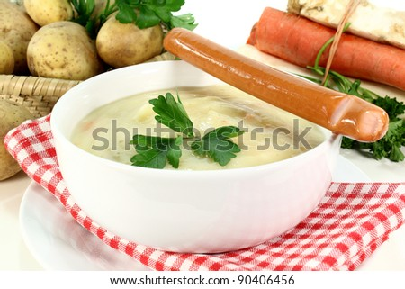 a bowl of potato soup with parsley
