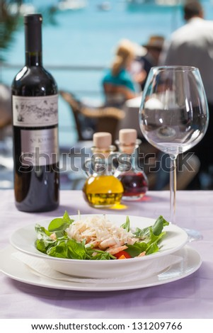 A bowl of prawns served with salad and cheese. - stock photo