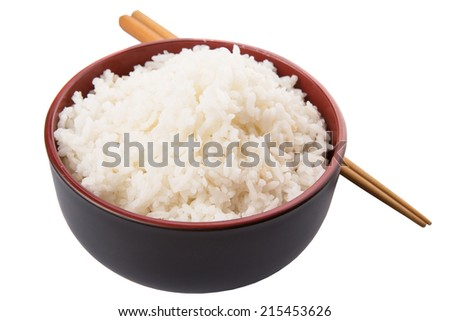 A bowl of rice and a pair of chopstick over white background - stock photo