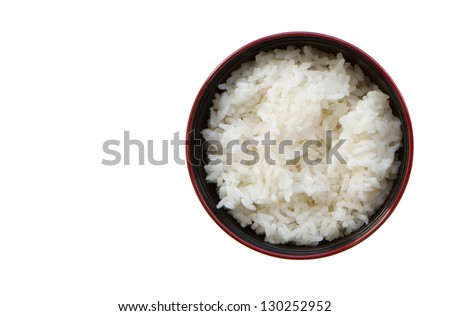 A bowl of rice on a white background. - stock photo