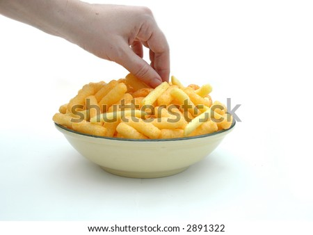 A bowl of snacks, isolated in a studio. - stock photo