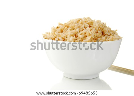 A bowl of steamed brown rice with copyspace